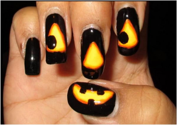 Glowing Jack O Lantern. Cool Halloween Nail Art which show off your spooky spirit during the freakish festivities.