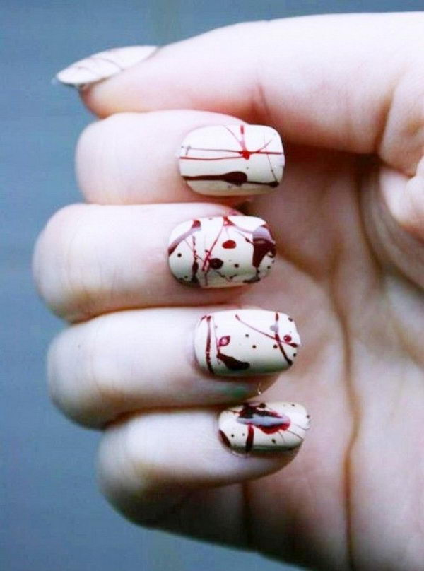 Chilling Blood Splatter Nail Design. Cool Halloween Nail Art which show off your spooky spirit during the freakish festivities.