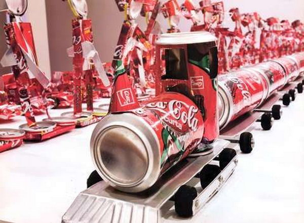 Train craft from coca cola cans. After drinking soda from aluminum cans, you can recycle your soda cans to create interesting projects instead of tossing the empty cans into the garbage or recycling bin.