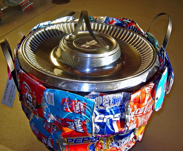 Container made from recycled soda cans. After drinking soda from aluminum cans, you can recycle your soda cans to create interesting projects instead of tossing the empty cans into the garbage or recycling bin.