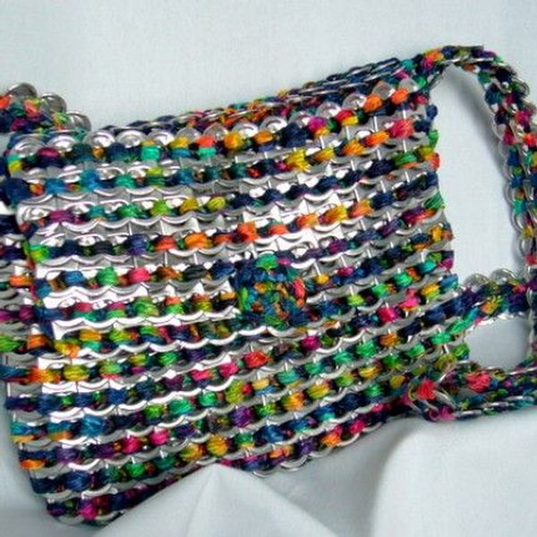 Make a purse out of can tabs with weaving. After drinking soda from aluminum cans, you can recycle your soda cans to create interesting projects instead of tossing the empty cans into the garbage or recycling bin.