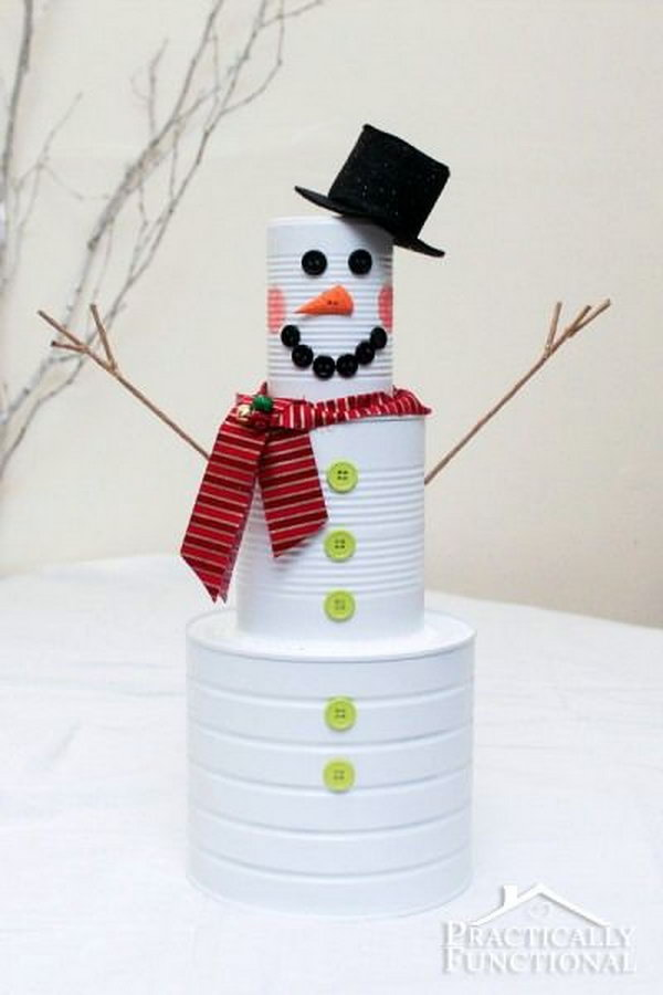 Tin can snowman for christmas. Tin cans are not just for stacking up in your cabinet, tossing in the trash or sending to the recycle bin. Combine those with a rope, paints, craft papers and a generous helping of crazy imagination, and you will have a cool creation on your hands.