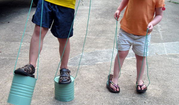 Tin can stilts. Tin cans are not just for stacking up in your cabinet, tossing in the trash or sending to the recycle bin. Combine those with a rope, paints, craft papers and a generous helping of crazy imagination, and you will have a cool creation on your hands.