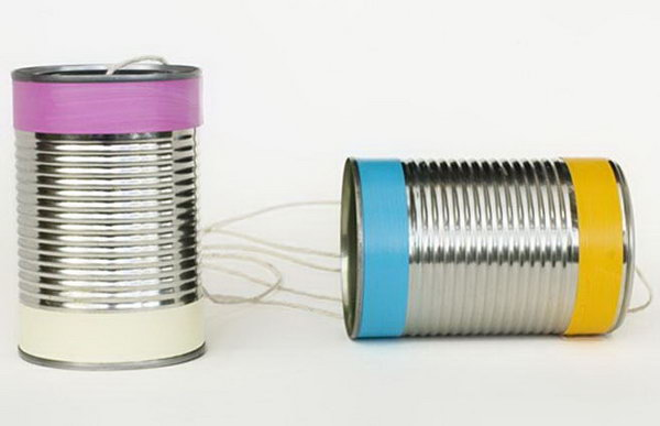 Tin can telephones. Tin cans are not just for stacking up in your cabinet, tossing in the trash or sending to the recycle bin. Combine those with a rope, paints, craft papers and a generous helping of crazy imagination, and you will have a cool creation on your hands.