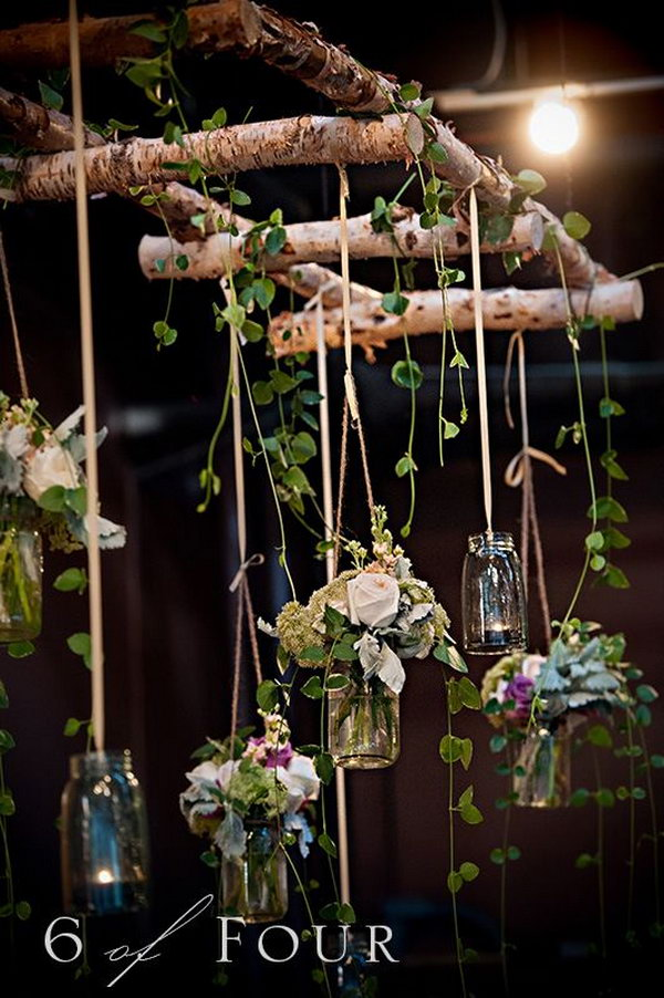 Natural elements, mason jars and the twig ladder make this wedding settings more than visually appealing.