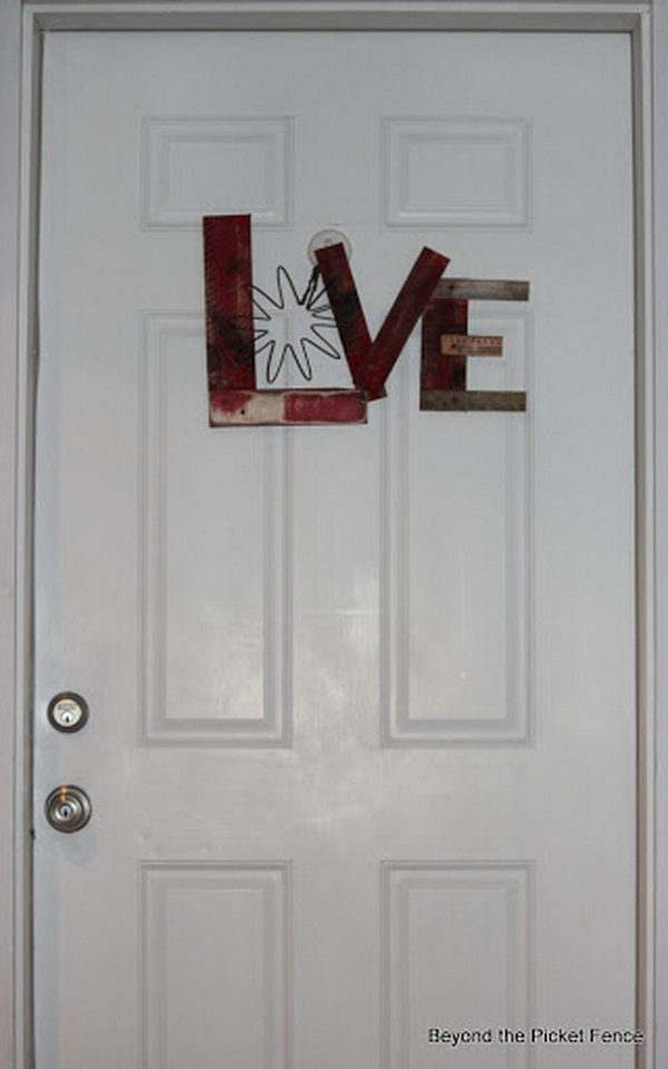 A cute LOVE sign door decorating idea for Valentine's day. A piece of a big spring was used for the letter O.