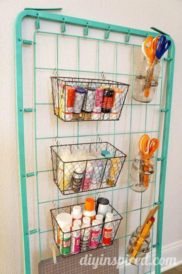 Use an old bed spring as a genius way to store all of your craft supplies.