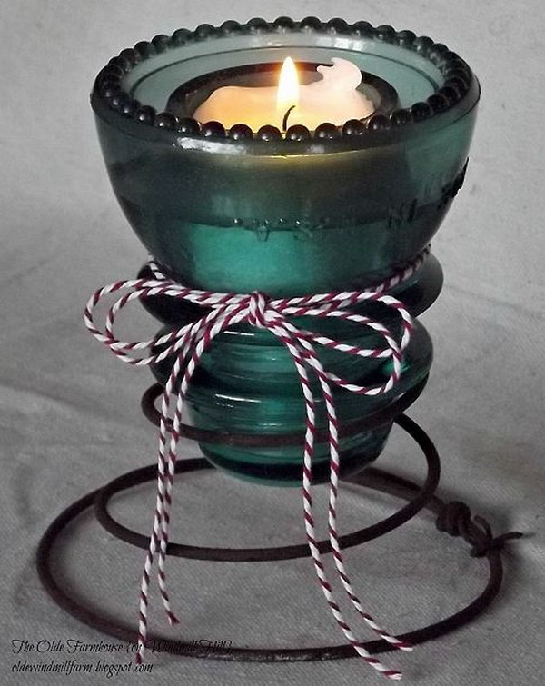 Rachel used rusty bed springs from a friend's back yard and an aqua glass insulator from his garage to create these cute little votive holders for a candlelit Valentine Party.