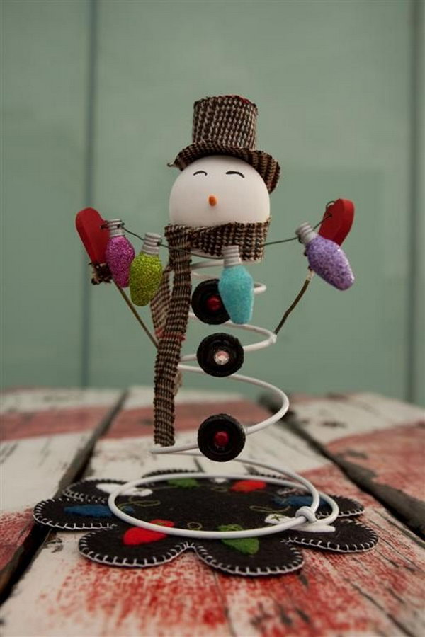 Adorable Snowman Made from an Old bed spring, a styrofoam ball and buttons,
