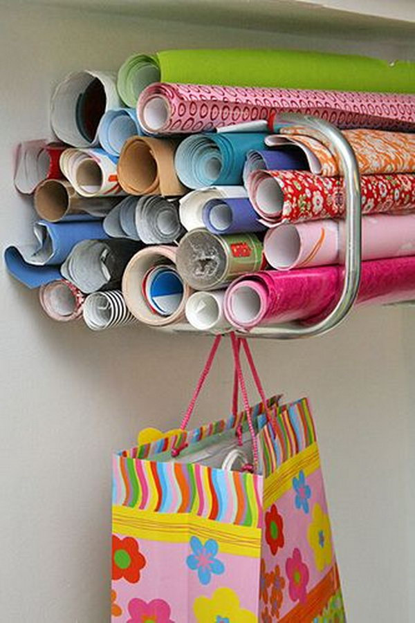 It's a clever idea to organize wrapping paper with bike racks.