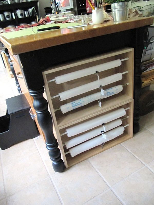 Build paper rolls organizers with tension rods and old drawers that fit between the legs of table. Label your rolls so you can tell what's what.