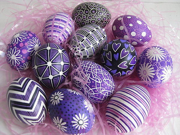 Purple and Lilac Pysanka Eggs. These pysankas painted with hot beeswas symbolize hope, life and prosperity.