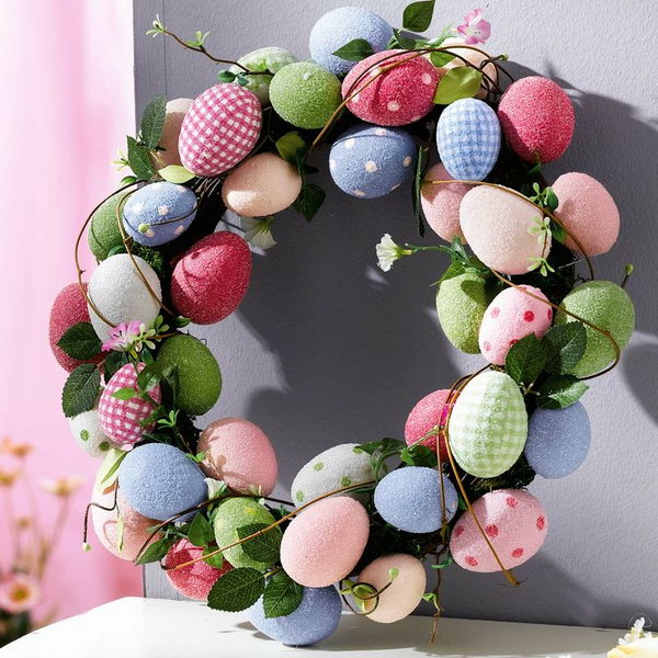 Use light color Easter Eggs with polka dots and leaves to decorate them into a Easter Egg Wreath.
