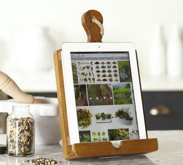 Kitchen Tablet Holder. This tablet holder would be a perfect present for your mom if she often need a tablet to try some new recipes in the kitchen.