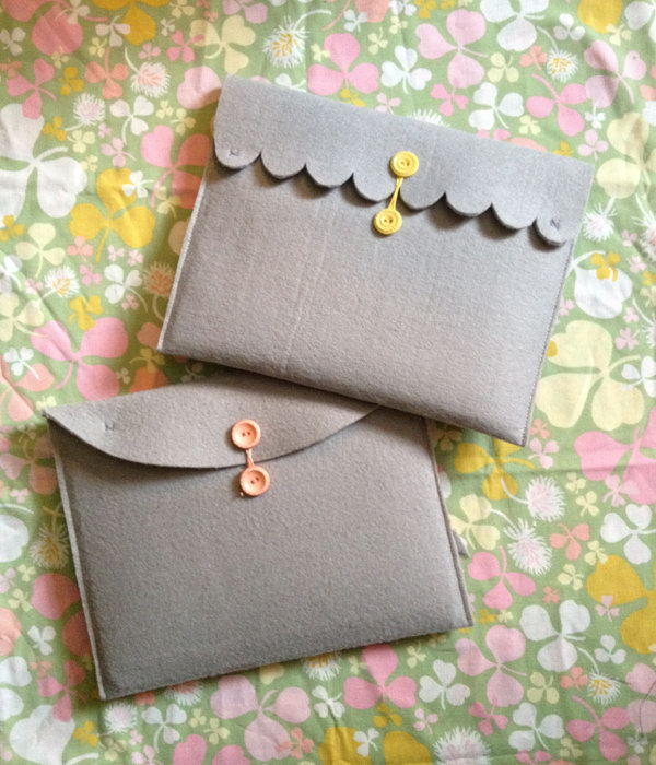 Felt iPad case. This is a super inexpensive way to get a custom iPad case with the materials, a piece of thick felt ,a pair of scissor, a sewing machine, needle and thread,two buttons,etc. that you can get around you.