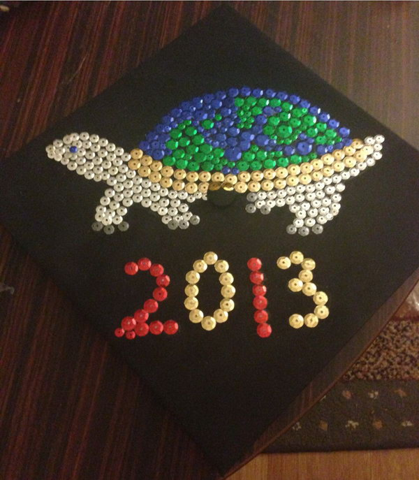 Turtle Carrying the Earth Graduation Cap. Decorate the graduate's cap with this turtle carrying the earth graduation cap with sparkling sequins to shine you through your bright future.