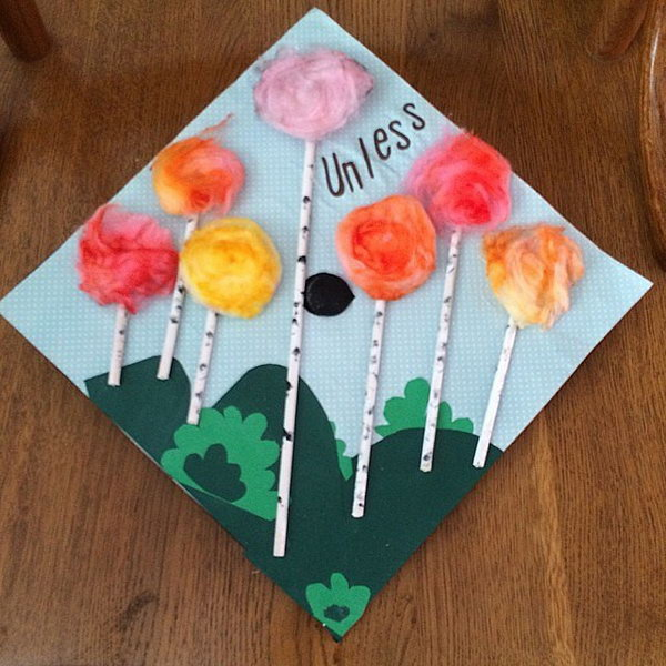 Floral Design Graduation Cap. Glue green grasslands on the cap board. Glue paper rolls and pomp pomps in bright colors  to create the delicate floral shape.