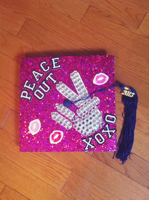 Victory Graduation Cap. This victory graduation cap is designed especially for girl graduates. It has victory gesture beadings above the glittering purple cap board. Finish off this charming cap with blue threads to create the tassel.
