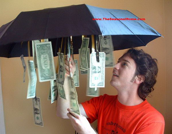 Cash Umbrella. Cut ribbons of various lengths, attach money to them and tie the ribbons inside the umbrella. The graduate must be disappointed to receive the ordinary umbrella. Once he or she opens it, the graduate must feel very exciting. I really enjoy this humorous gift.