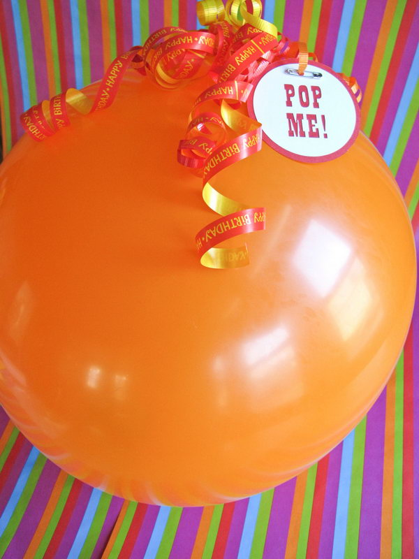 Gift Wrapping Balloon Pop. It's such a creative idea to pop a balloon to get your gift. Use balloon large enough to fit a small box or card within. It's perfect to put some sash inside. The graduate just can't wait to open this exciting gift wrapping balloon pop.