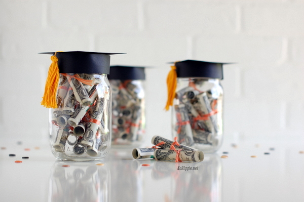 Mason Jar Graduation Cap. Create the lid of the Mason jar to make the graduation cap. Roll up bills in a diploma style and add the twine to tie the bow. The graduate must be very pleased to receive this graduation cap Mason jar filled with bills.