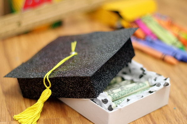 Cash Diploma. Congratulate to the graduate's academic achievement with this funny cash gift. It features a plain box in a glittering black graduation cap. You can fill it with rolls of money in diploma style as you like.