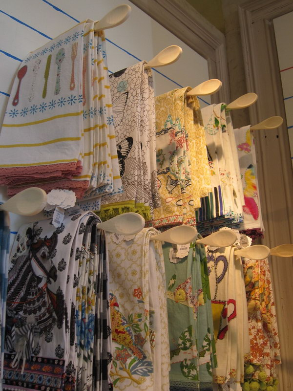Wooden spoon racks. Hang towels on racks made of wooden spoons. It saves your space and keep your towels dry.