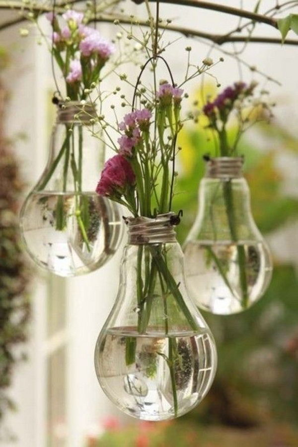Use old bulbs as vases. The bulb vase with beautiful flowers looks like a crystal ball. What a cool decoration idea.