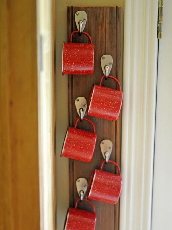 Personal hooks made from a coat rack. To encourage your kids to drink more water, install a coat rack on the wall, and everyone will have their own hook based on their height.