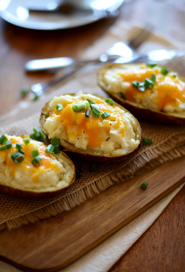 Cauliflower Twice Baked Potatoes. What a cheesy, mouthwatering twice baked potato with steamed cauliflower inside. It's perfect to serve your gusts with this vegetarian dish.