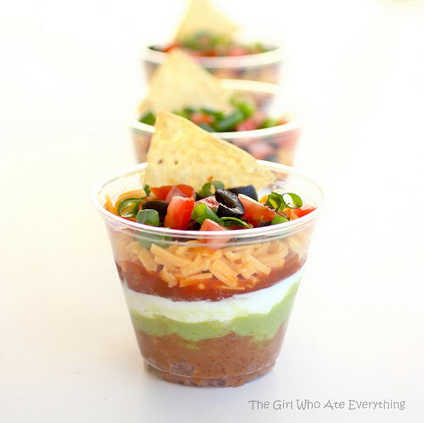 Individual seven layer dips. You may wonder how to create these colorful seven layers. This appetizer combines beans and taco seasoning, sour cream, guacamole, salsa or pico de gallo, cheese, tomatoes and green onion. It's perfect for a normal party or get together.