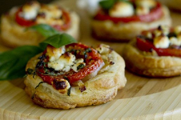 Tomato and Goat Cheese Tarts. Treat your guests with this perfect savory appetizer or side dish. They must enjoy the sweet flavor of tomatoes and the goat cheese makes the perfect compliment with the pastry.