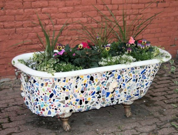 Creative planter made from the old bath tub and leftover ceramic tiles.