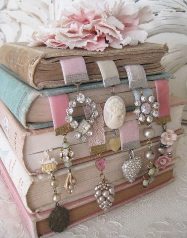 Beautiful Bookmark.  Cut velvet ribbon, use flat nose jewelry pliers to affix clamps to both ends. Add some vintage earrings or trinkets to finish this cheap gift off in an exquisite design for bookmarking.