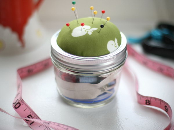Mason Jar Sewing Kit. Stuff batting inside the lid and seal up the fabric to create the pin cushion for the lid, glue along the line of this pin cushion lid. This gift is super easy, it's cheap yet elegant.