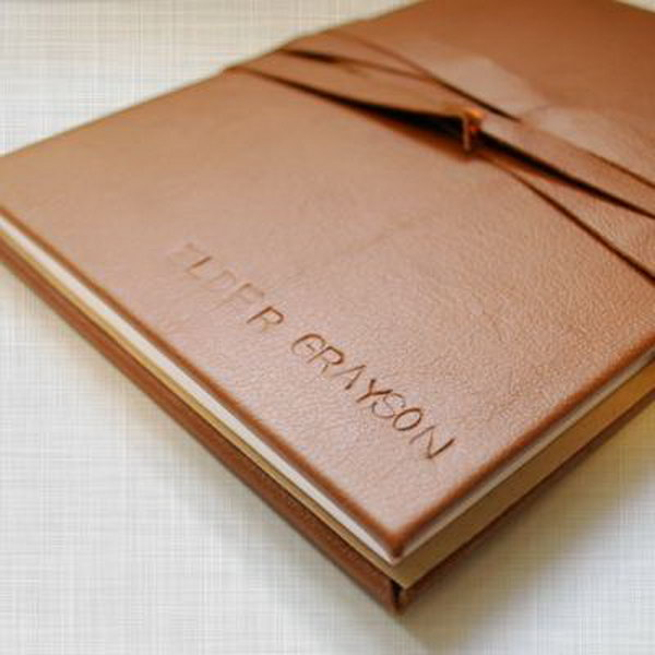 Leather Journal. Creating a unique leather journal for your loved man is a fabulous gift idea if he loves writing. Personalize it with his name or initials.