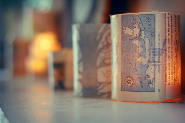 Map Votive. Rinse out jars and remove labels, glue map pages onto jars with mod podge, place candles inside to finish off this piece or art to offer a beautiful decor especially for your dinner party.