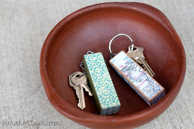 Jenga Keychain. Screw eye into the block, apply mod podge to the map paper and place on the Jenga block, attach the key ring to finish off this gorgeous artwork for beautiful decor.