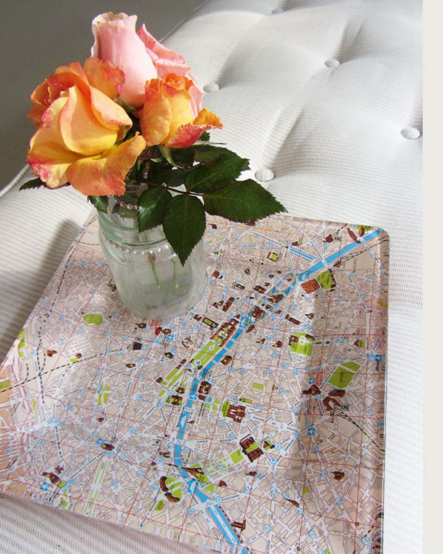 Map Serving Tray. Spread layer of decoupage medium on the glass plate and glue the paper map at the bottom. In this way, the map pattern is visible through the glass. This tray must be a focal point on your party.