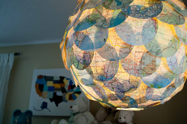 DIY Map Pendant. Glue dozens of cut out circles on the white plain paper lantern. At night time, you'll be amazed at the soft light ambiance.