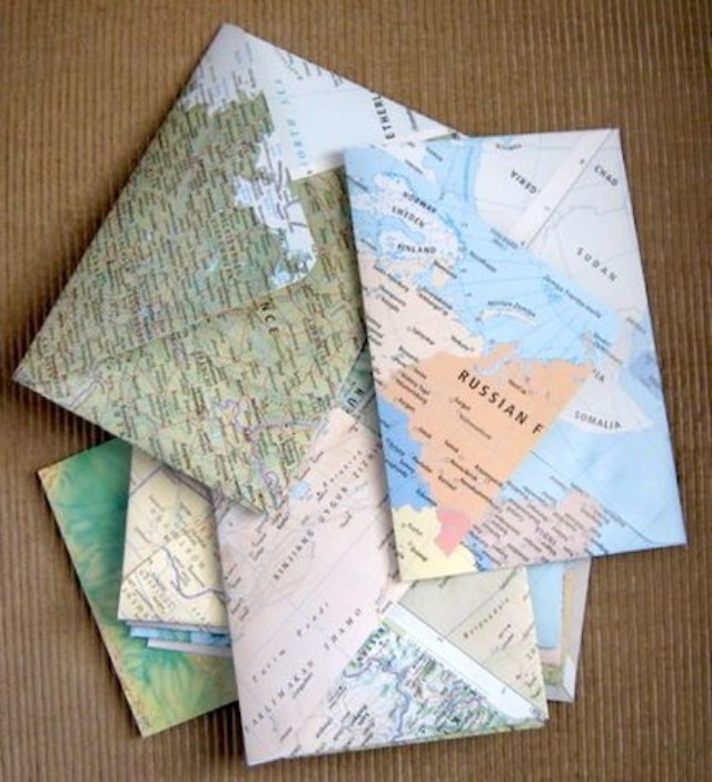 Map Patterned Envelope Art. Use the open envelope as the template to cut the shape from the map paper. Fold it in the same place as the original one and glue together. It's super chic to turn the dreary map page into this lively and cool map patterned envelope.