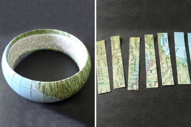 Vintage Map Bangle. Cut maps into strips, line them up and make the edges overlap, glue them on the bracelet and you can glue something unexpected on the inside to finish off this interesting vintage map bangle.