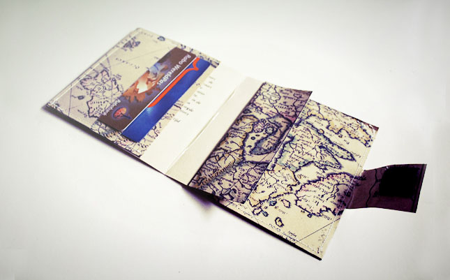 Map Wallet. Sew map paper along the outside of the wallet to secure, use adhesive Velcro and put it on the closing of the wallet and the little pocket inside to secure. You've got the whole world in your hands with this nifty work of art.