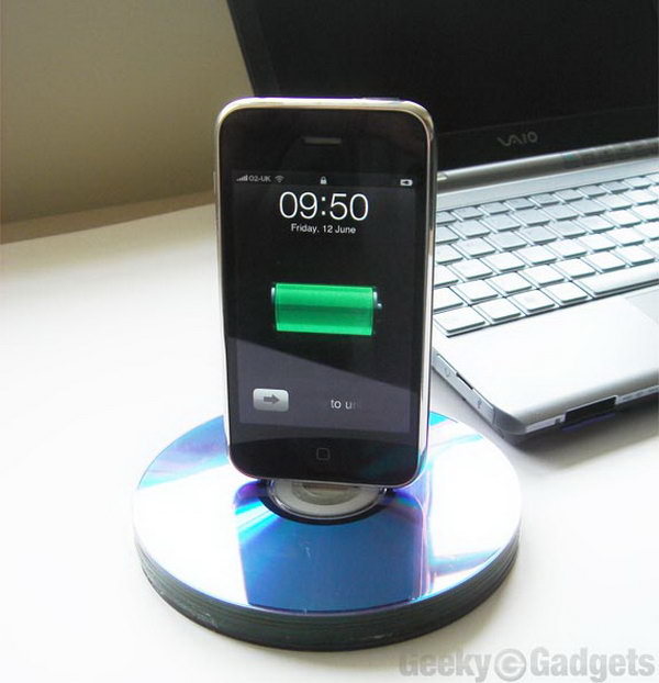 Recycled CD iPhone Dock. Align all the cuts out and insert the charging connector into the stacked disks. Glue the cable channel disks to make this charging end pass right through but as a tight fit. You must enjoy the beautiful display of your device with low budget.