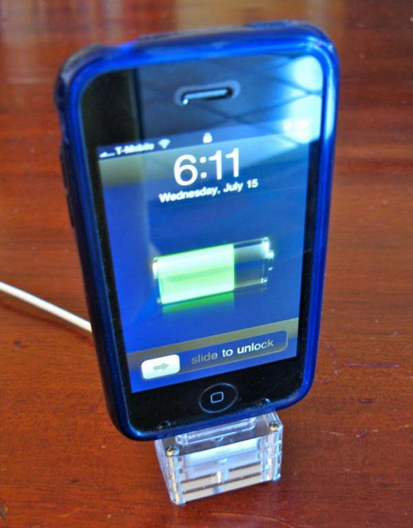 Quickie Laser cut iPhone Dock. Create this iPhone dock with four slices of acrylic. The top two with oval opening to fit the connector, the third one with a channel to go through the cable and the last one with bottom slice to keep the cable from falling out. You must like this brilliant design to display your device.