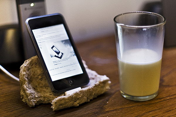 Bread Shape iPhone Dock. As its name suggests, this iPhone dock features its cool outlook, this docking station looks like a slice of bread with a bite taken out of it. It's super chic to display your device with this cool design.