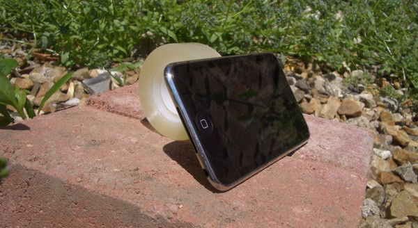 Sticky Tape Stand. For those who would like to create a simple stand in within ten minutes to enjoy the movies at a perfect angle, this one would be the perfect choice. Just stick a bit of tape to the back of you iPhone device then you can sit and enjoy.