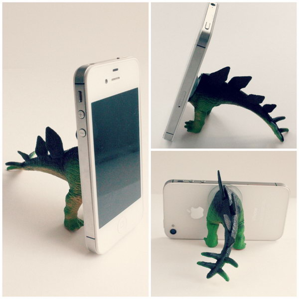 Dino iPhone Tripod. Cut your dinosaur in half, inject it with caulking, dab a little caulking on the feet and tail as well to avoid sliding. It's super easy, funny yet inexpensive.