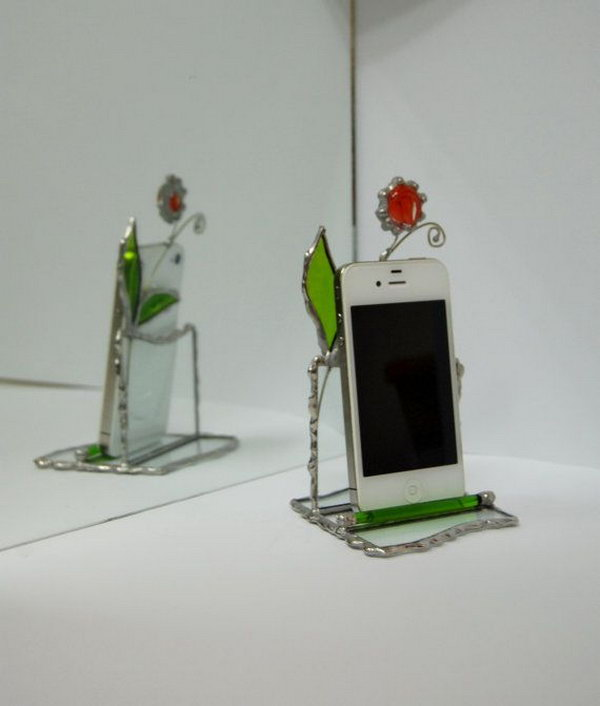 Stained Glass iPhone Stand. This stained glass stand for iPhone made by transparent glass and decorated with green glass leaves and red glass flower on adjustable wire is perfect to display your iPhone in an elegant way.