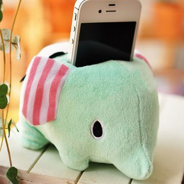 Cute Sweet Plush Elephant iPhone Stand. This plush holder features adorable cartoon elephant shape.  It's perfect to display your iPhone device with this beloved stand in warm toned color.